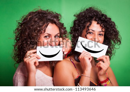Two Young Women with Smiley Emoticon on Green Background