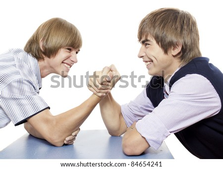 Two youth are doing arm wrestling