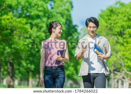 Two youths walking while talking Stock photo ©