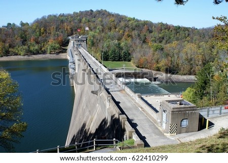 Tygart Dam in West Virginia, showing the river high on the left and low on the right, and tree-covered mountains beyond. #622410299