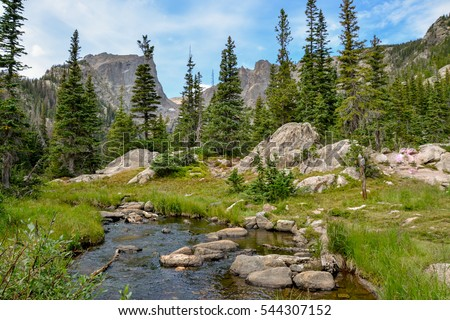 Tyndall creek crossing Emerald Lake trail with Hallett peak in the background Rocky Mountain National Park, Estes Park, Colorado, United States Stock photo ©