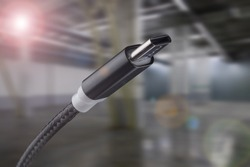 Type-C USB cable on an industrial background.
