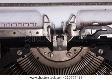 type writer with blank white paper