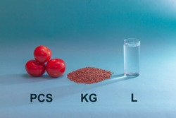Types of units of measurement for food: kilograms, pieces, liters. Tomatoes, buckwheat, water on a blue background.