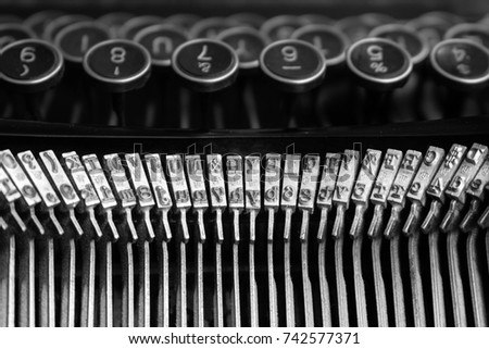 Typewriter front view of type bars and reverse view of keys