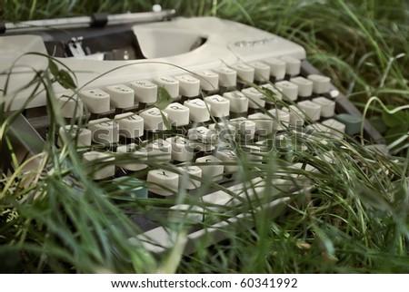 Typewriter in grass