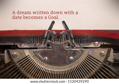Typewriter typed text of a dream written down with a date becomes a goal