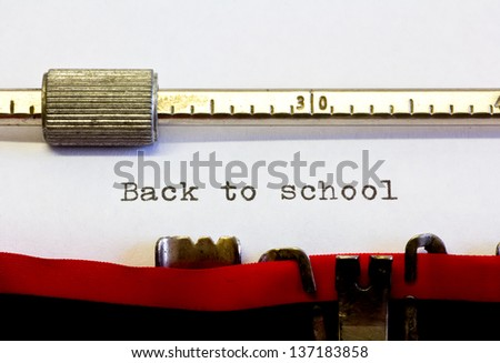 typewriter with the following text: back to school