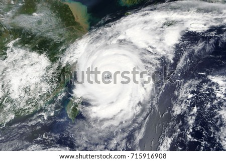 Typhoon Talim is heading towards China and Taiwan - Elements of this image furnished by NASA  #715916908