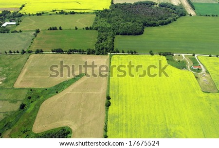 Typical aerial view of green fields and farms. Durham region, Ontario, Canada. Summer time.