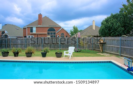 Typical American backyard with swimming pool. #1509134897
