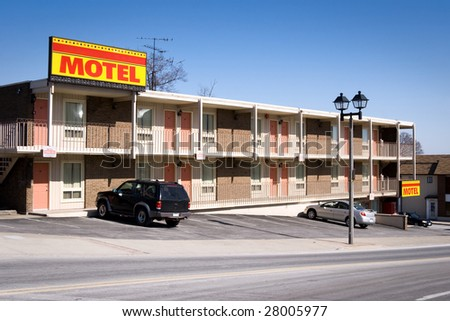 Typical american inexpensive motel with parking and separate rooms. Shot in Niagara Falls, Ontario, Canada.