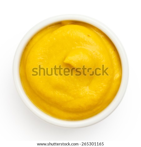 Typical american smooth yellow mustard in round dish from above on white. #265301165