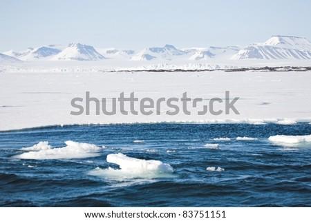 Typical Arctic winter landscape - mountains, sea, glaciers