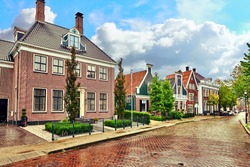 Typical, authentic village with cozy houses of the  countryside in the Netherlands.
