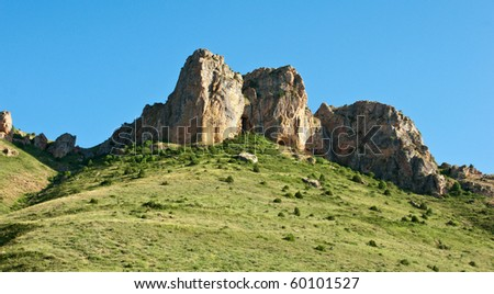 Typical beautiful caucasian mountain landscape with blue sky