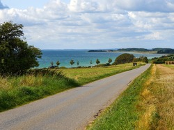 Typical beautiful natural Danish coastline beach landscape in the summer Fyn Funen Denmark
