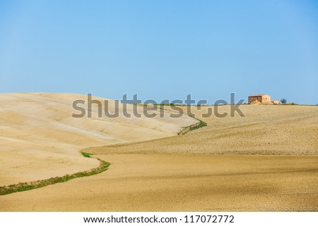 Typical beautiful Tuscan landscape-trees, autumn, grass, sky, villa. Italy