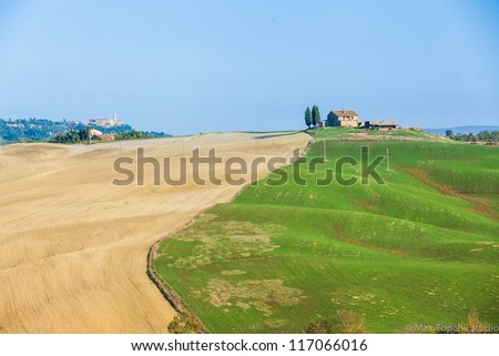 Typical beautiful Tuscan landscape-trees, grass, sky, villa. Italy