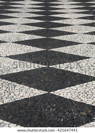 """Typical black and white, Portuguese """"calcada"""" mosaic cobble stone paving. Tomar, Portugal. Also found in Brazil and other countries which were Portuguese colonies."""