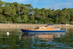 Typical boat from the Arcachon Bay, view from the sea, reflections in the water, Cap-Ferret