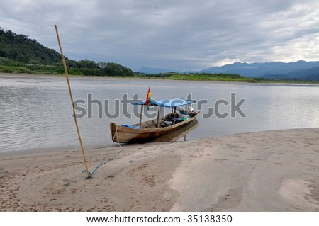 typical boat in amazonia - stock photo