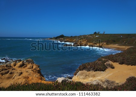 Typical californian landscape. Coastline of Pacific Ocean with rocks and sand