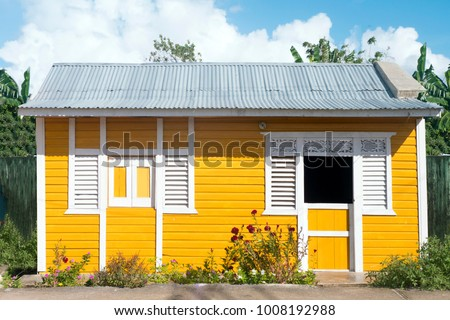 Typical Caribbean house, yellow.
