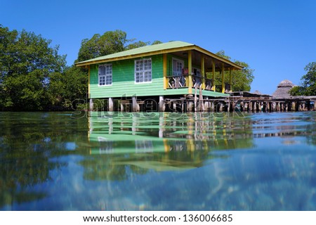 Typical Caribbean stilt house over water of the Caribbean sea, Bocas del Toro archipelago, Panama