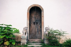typical china architecture, old wooden door with stone lions in the garden