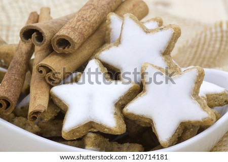 typical christmas cinnamon star cookies and cinnamon sticks