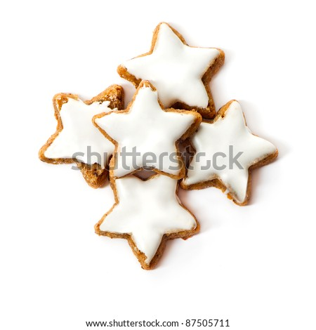 typical christmas cinnamon star cookies isolated on white