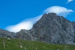 Typical clouds surrounding a peak during foehn, a stormy wind in Switzerland