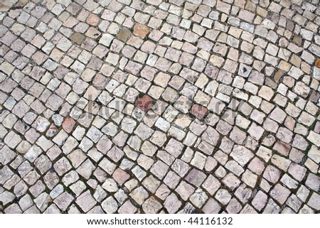 Typical cobblestoned street in Portugal suitable as a background.