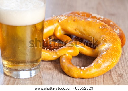 Typical crusty german pretzel bread with beer