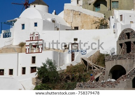Typical cubiform houses on the cliffs of Fira village on Santorini Island, Greece. #758379478