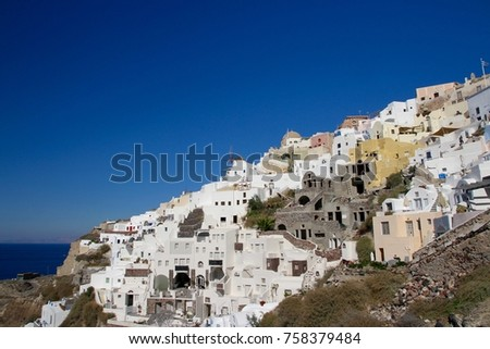 Typical cubiform houses on the cliffs of Fira village on Santorini Island, Greece. #758379484