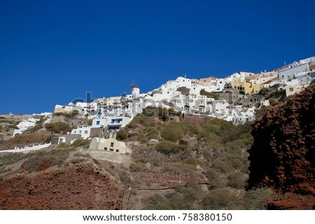 Typical cubiform houses on the cliffs of Fira village on Santorini Island, Greece. #758380150