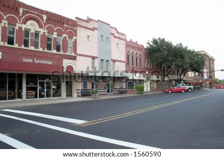 Typical downtown main street complete with furniture store and movie theater that could be almost any town in the Mid West United States.