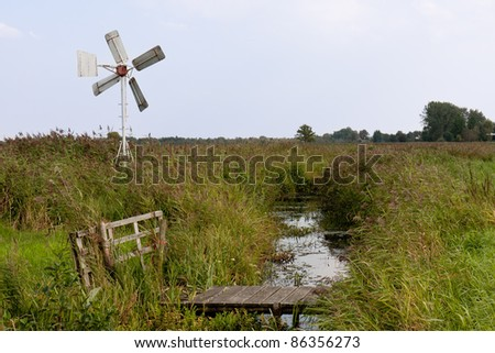 Typical Dutch agrarian windmill for dry milling of farmland - stock photo