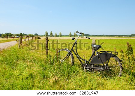 Typical Dutch an old bike in Hollands landscape