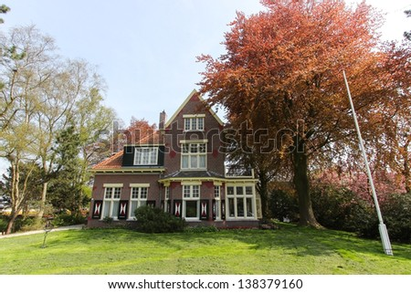 Typical dutch house with red bricks and nice garden in Keukenhof, The Netherlands