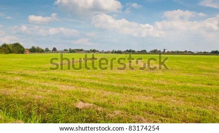 Typical Dutch landscape with grass and a small village