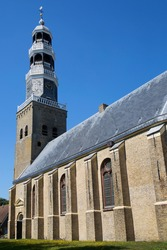 Typical Dutch large historic church with a tall bell tower