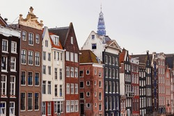 Typical dutch narrow houses with wide windows in Amsterdam, Holland, Netherlands