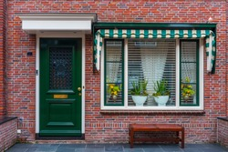Typical Dutch village houses facade. Beautiful and authentic style at Volendam. North Holland, Netherlands.
