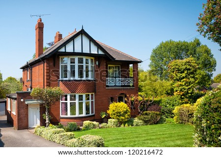Typical English house with a garden - stock photo