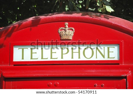 Typical English phone booth painted in red