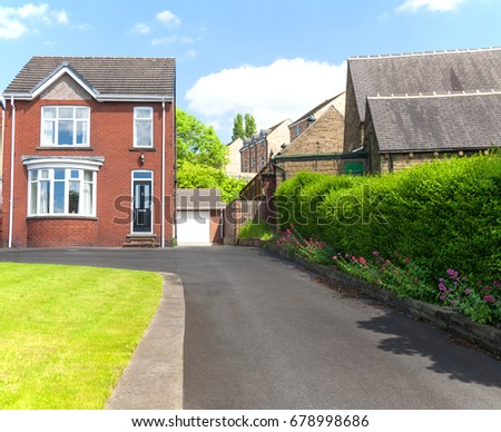 Typical English single family house built of red bricks, with a large driveway #678998686