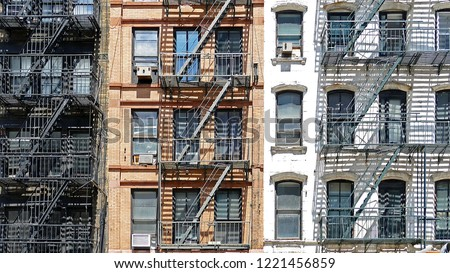 Typical fire escape by the colorful houses of New York City, USA